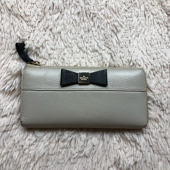 kate spade Handbags - Kate spade taupe large wallet with bow